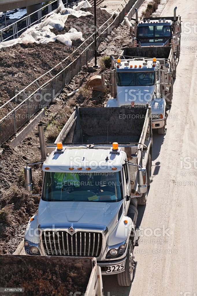 Dump trucks assisting with removing debris the flood in Calgary royalty-free stock photo