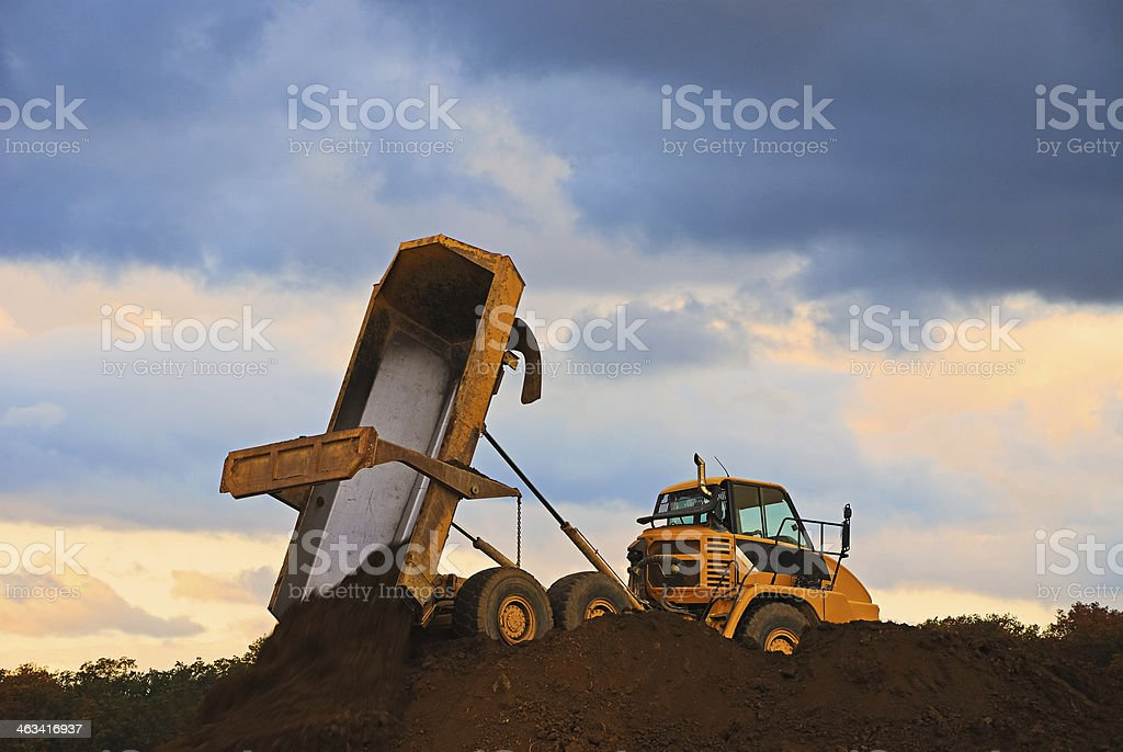 dump trucks at construction site stock photo