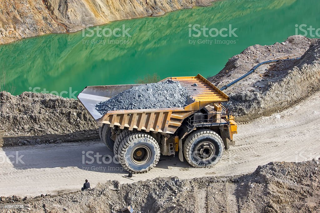 Dumper in open pit stock photo
