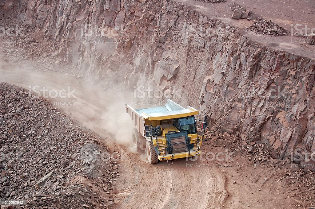 dumper truck driving through the quarry. mining industry stock photo