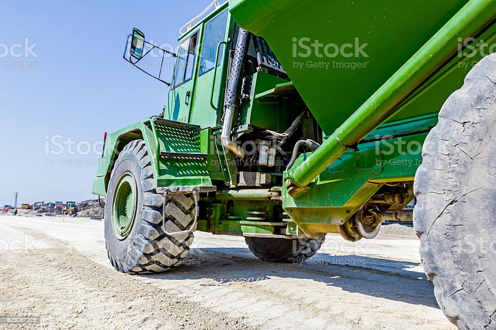 Dumper truck is going over construction site stock photo