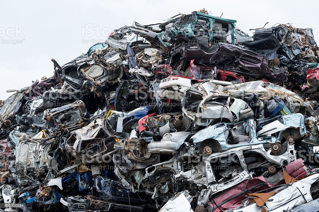 Dumping ground. Scrap metal heap. Compressed crushed cars is returned stock photo