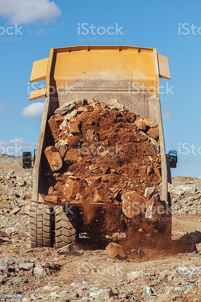 Dumping Load of Rock stock photo