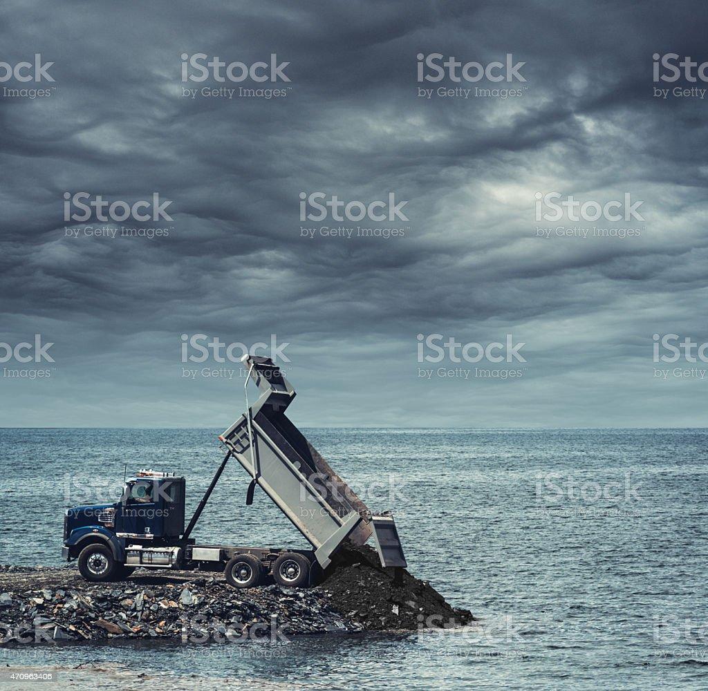 Dumping Soil into the Sea stock photo