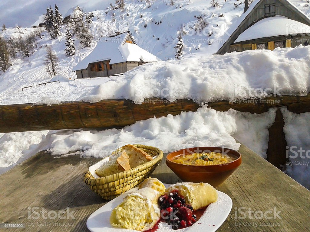 Dumplings, bread and stew in winter resort stock photo