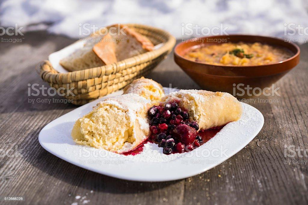 Dumplings, bread and stew on  plateau Velika Planina stock photo