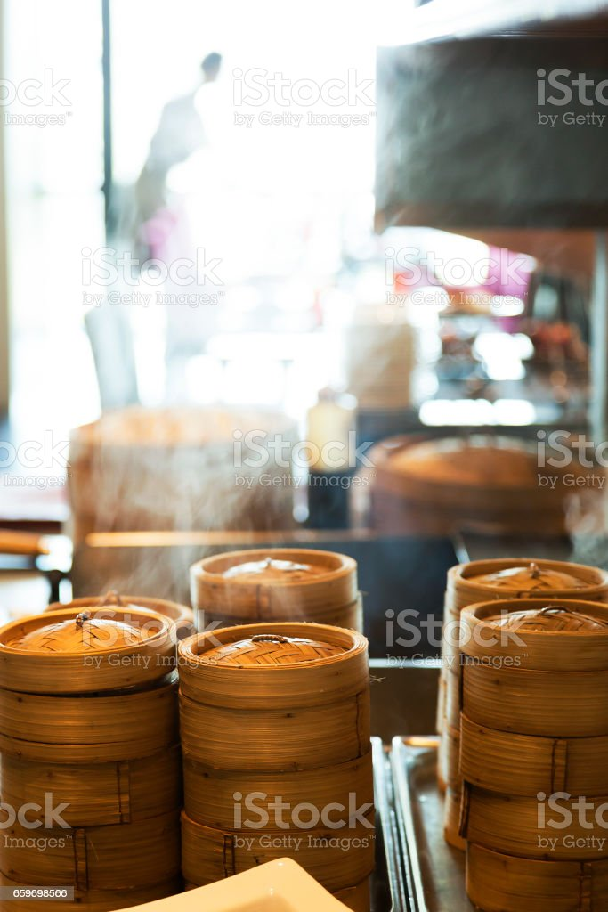 Dumplings cooking inside traditional bamboo steamers stock photo