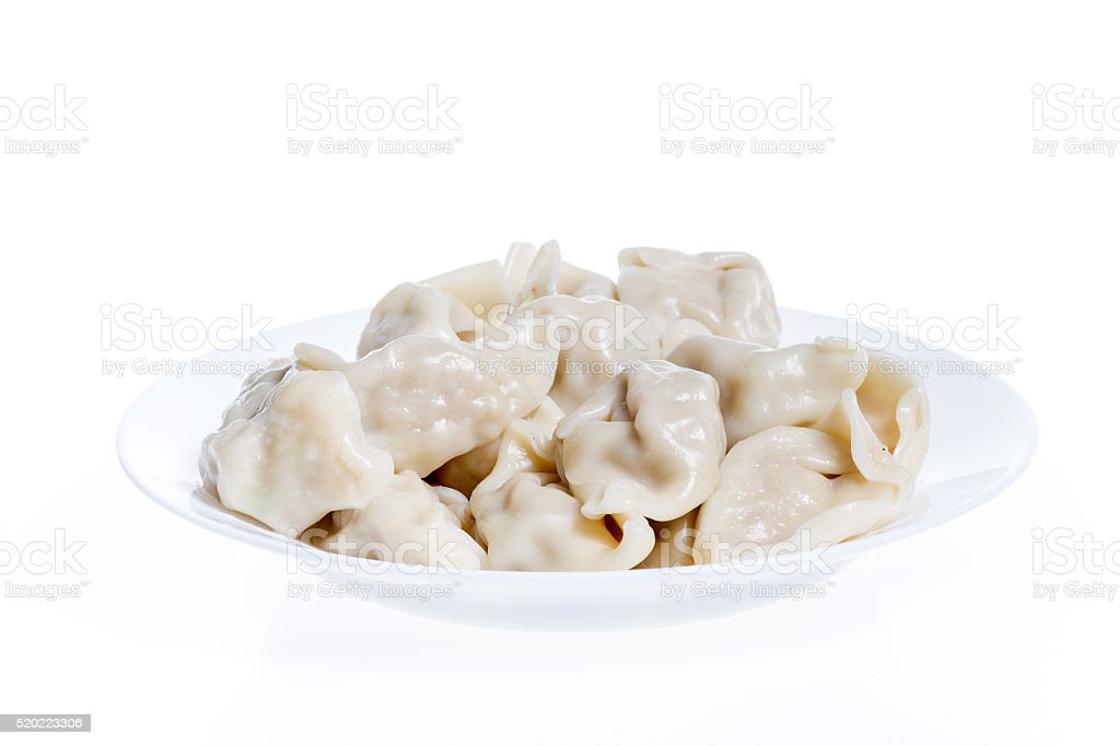 Dumplings in a plate isolated on white background stock photo