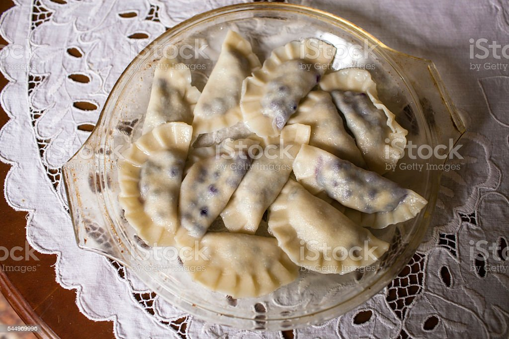 Dumplings stuffed with blueberries stock photo