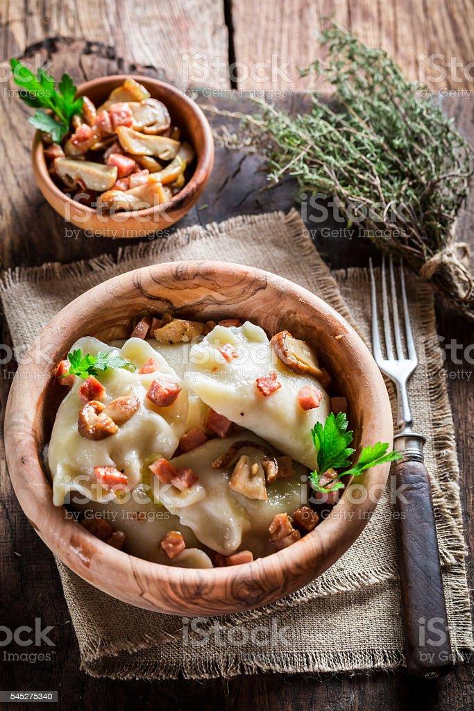 Dumplings with wild mushrroms and sauerkraut stock photo