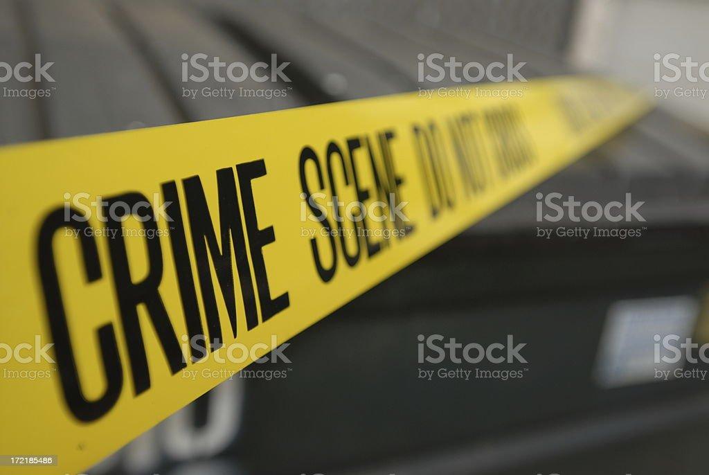 Dumpster and Crime scene tape stock photo
