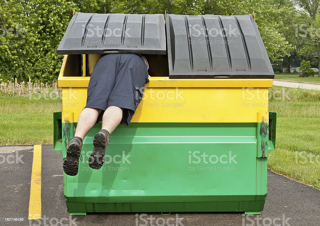 dumpster diver royalty-free stock photo