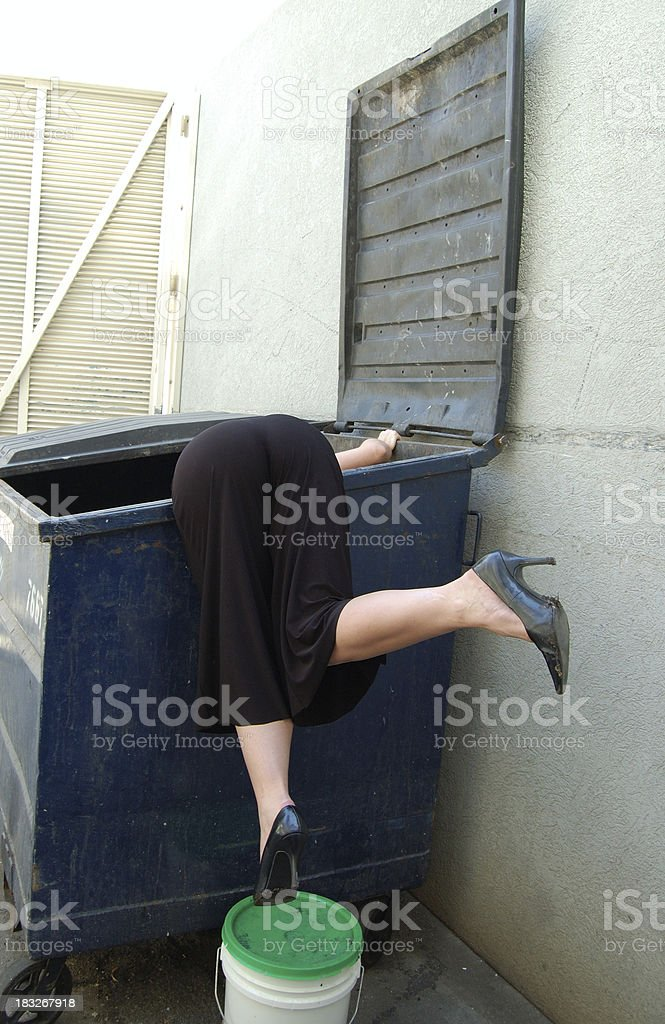 Dumpster diving stock photo