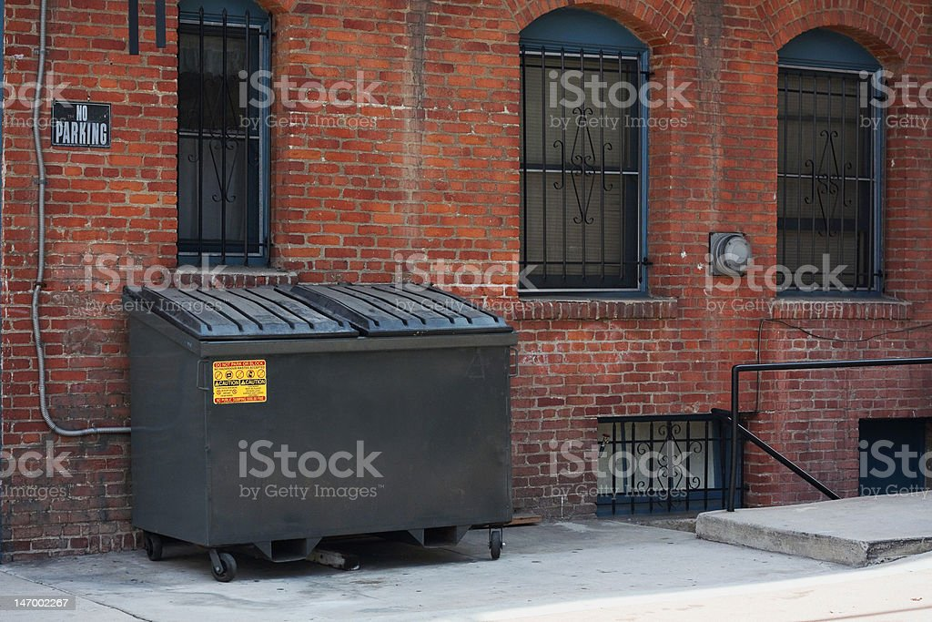 dumpster in an alley stock photo