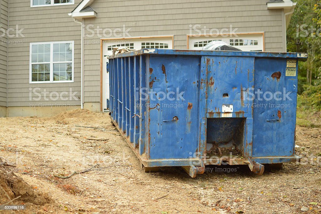 Dumpster on dirt stock photo