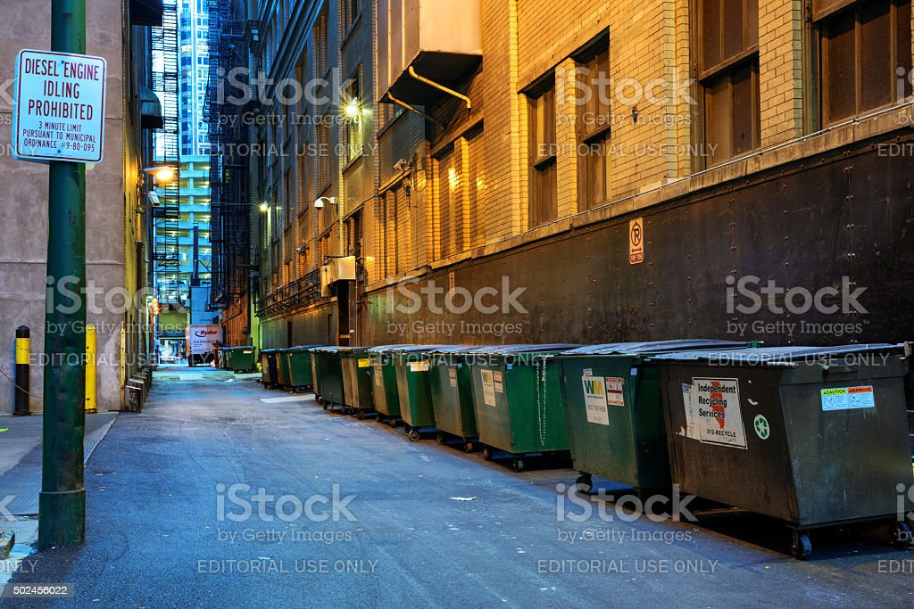 Dumpsters lining service alley, downtown Chicago stock photo