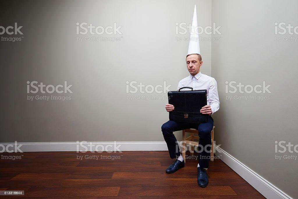 Dunce businessman stock photo