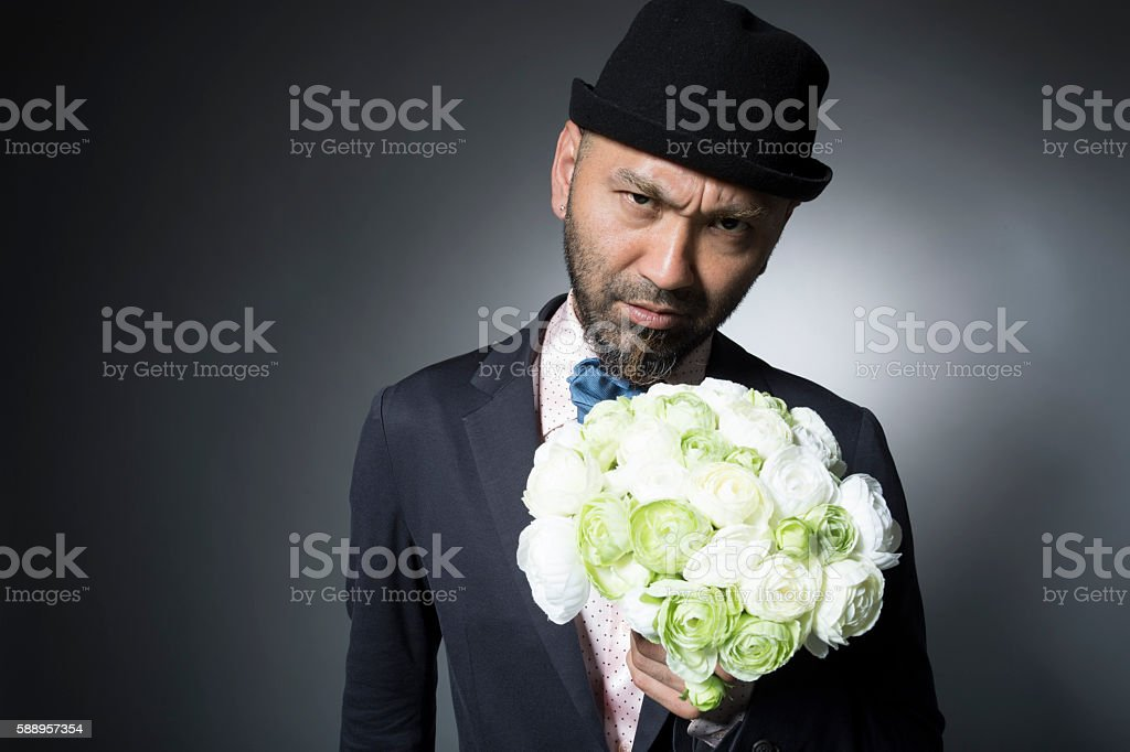 Dundee man with a bouquet for a marriage proposal stock photo