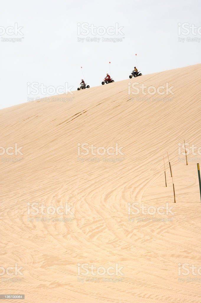 Dune Buggy Riders on High Sand Dunes stock photo
