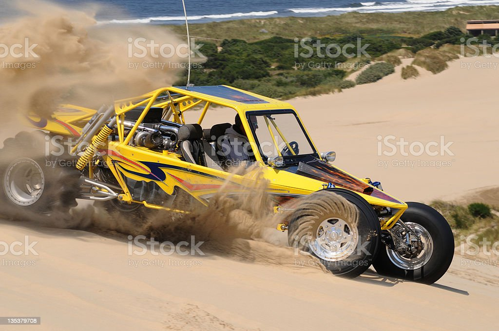 Dune Buggy, Yellow, Throwing Sand in Turn, Winchester Bay , Oregon royalty-free stock photo
