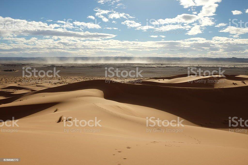 Dune Landscape of Sahara Desert with Distant Dust Storm stock photo