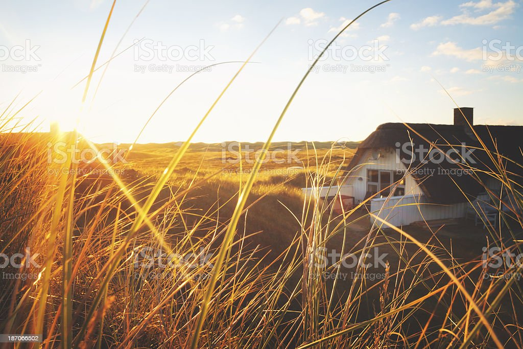 Dune with little holiday home stock photo