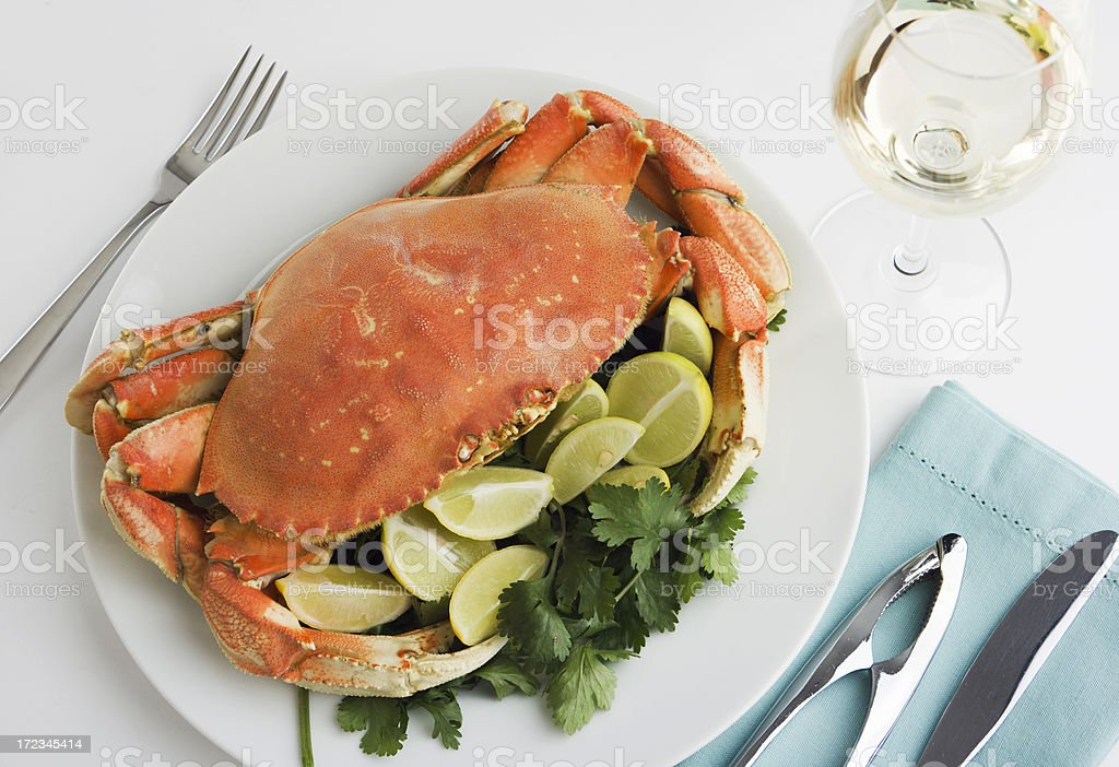 Dungeness Crab Seafood Dinner, Cooked, Prepared, and Served with Wine stock photo