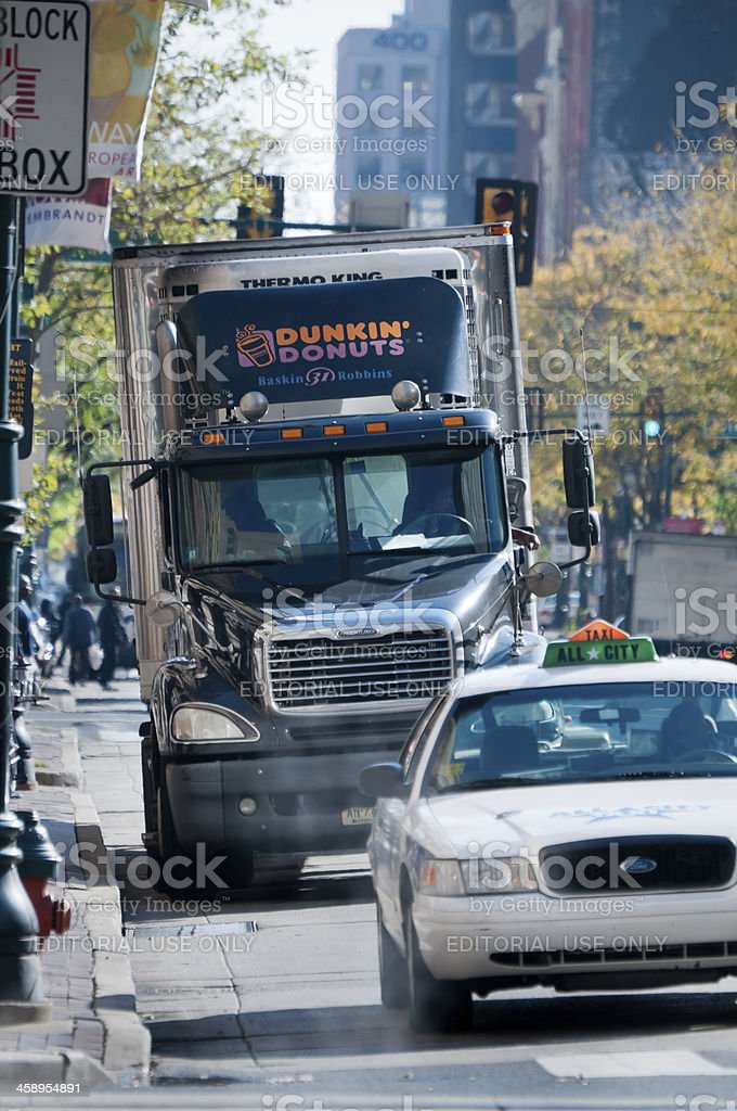 Dunkin Donuts delivery truck in downtown Philadelphia, USA stock photo