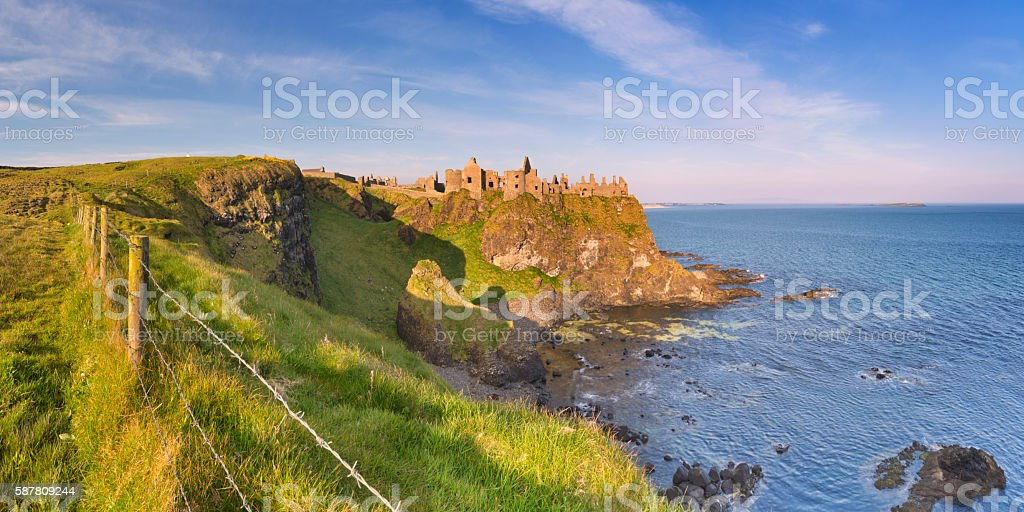 Dunluce Castle in Northern Ireland on a sunny morning stock photo