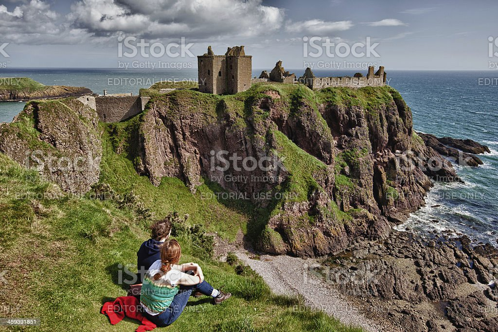 Dunnottar Castle and Young Couple stock photo