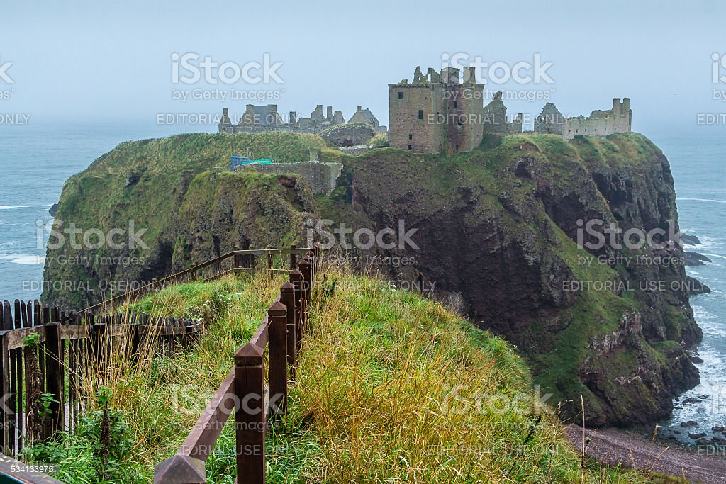 Dunnottar castle promontory and fence stock photo