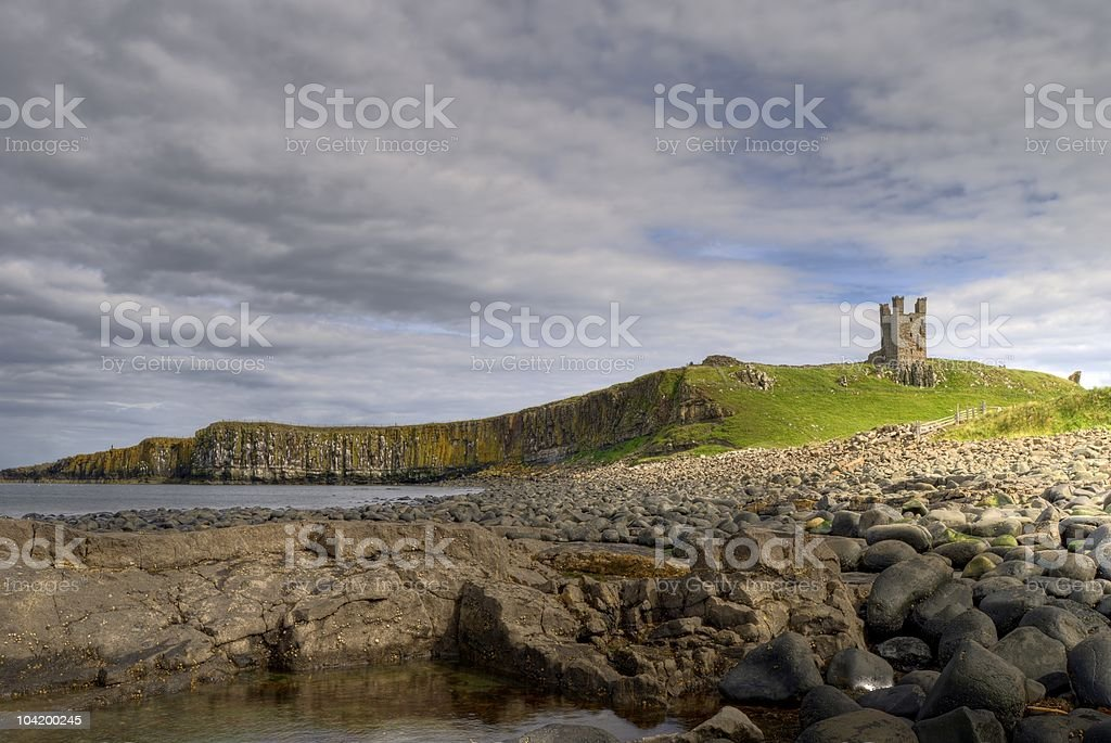 Dunstanburgh Castle and coast stock photo