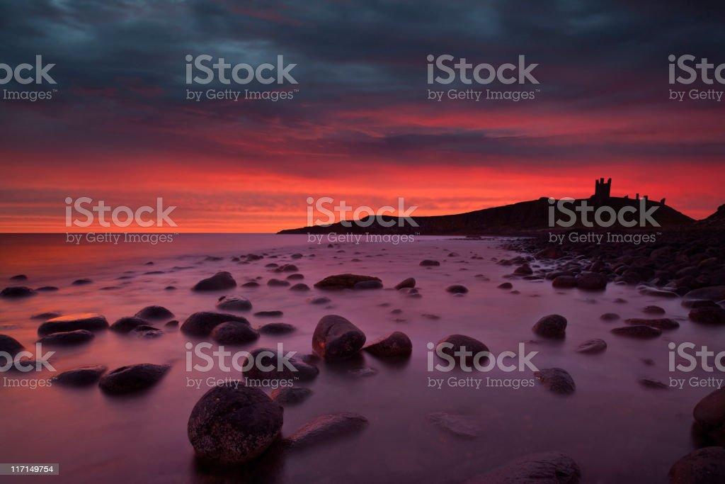 Dunstanburgh Castle at Dawn. stock photo