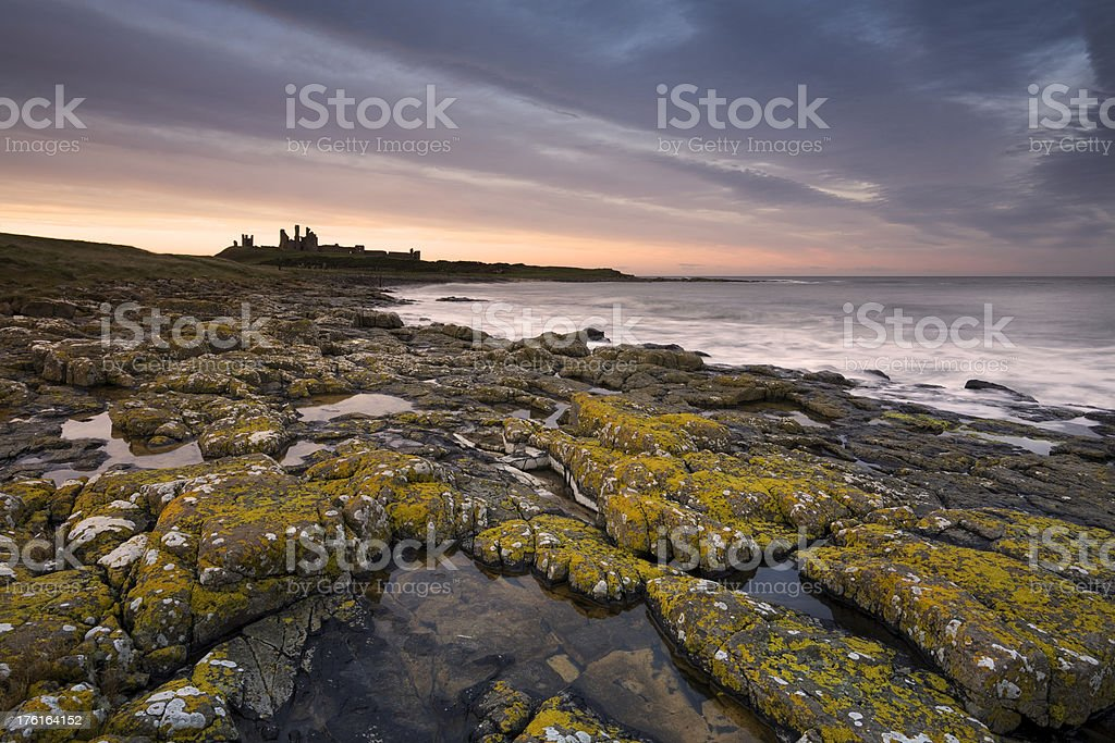 Dunstanburgh Castle at Sunset stock photo