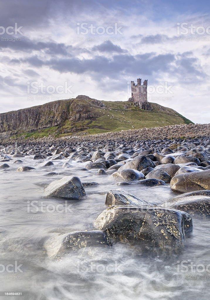 Dunstanburgh Castle Boulders stock photo