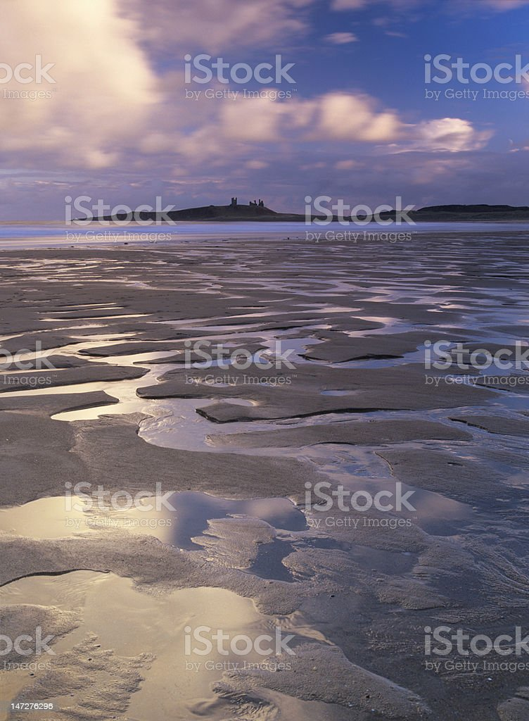 Dunstanburgh Castle from Embleton Bay royalty-free stock photo