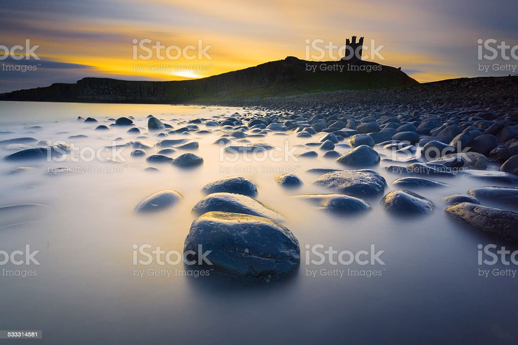 Dunstanburgh Castle morning royalty-free stock photo