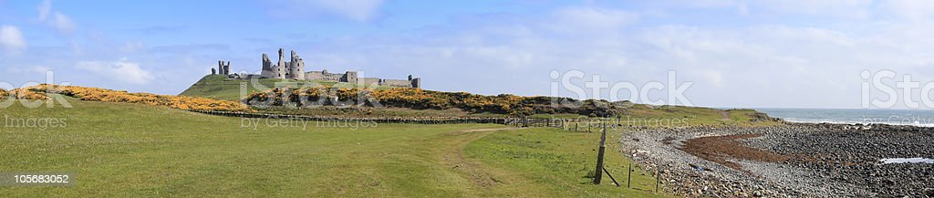 Dunstanburgh castle northumberland coast royalty-free stock photo