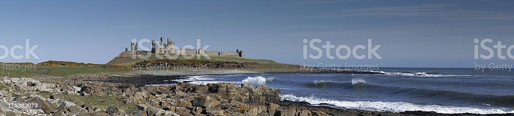 Dunstanburgh castle Northumberland England panoramic stock photo