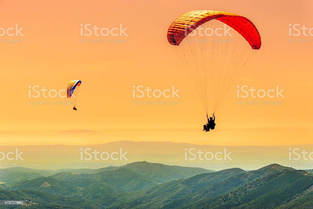 Duo paragliding flight stock photo