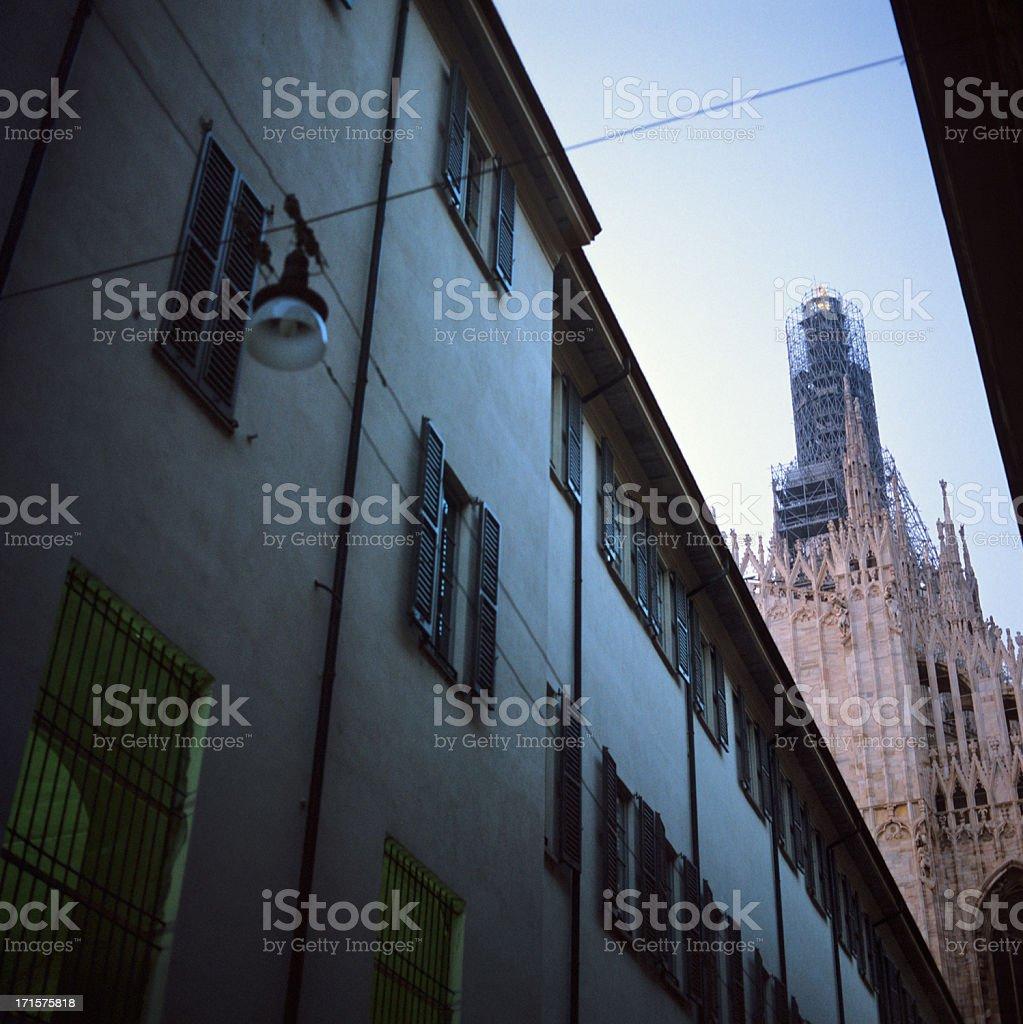 Duomo di Milano visto da Via Palazzo Reale undergoing restoration stock photo