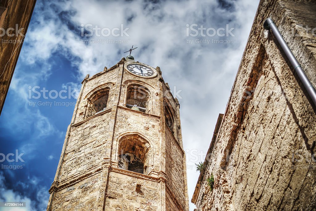 Duomo steeple seen from below on a cloudy day stock photo