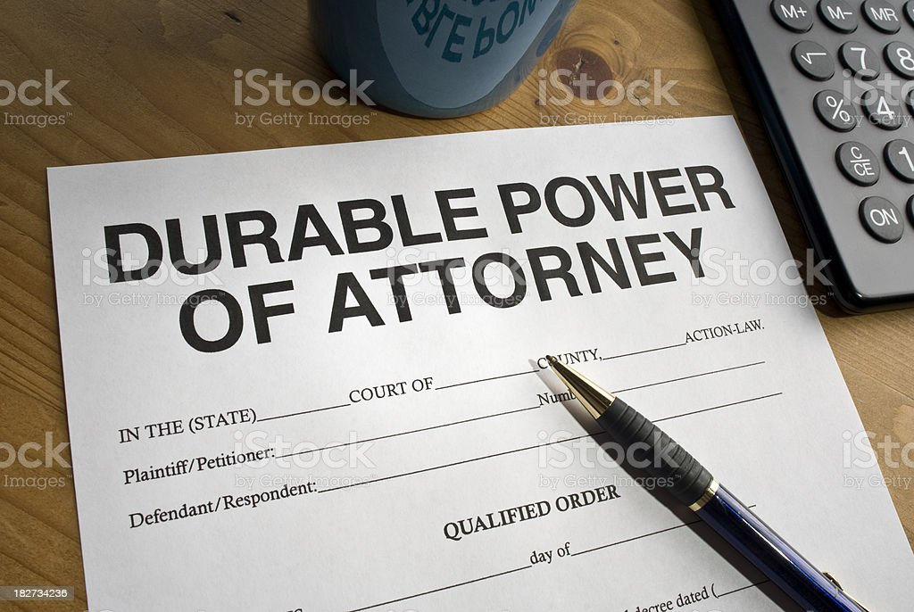 Durable power of Attorney paperwork on wooden desk with pen stock photo