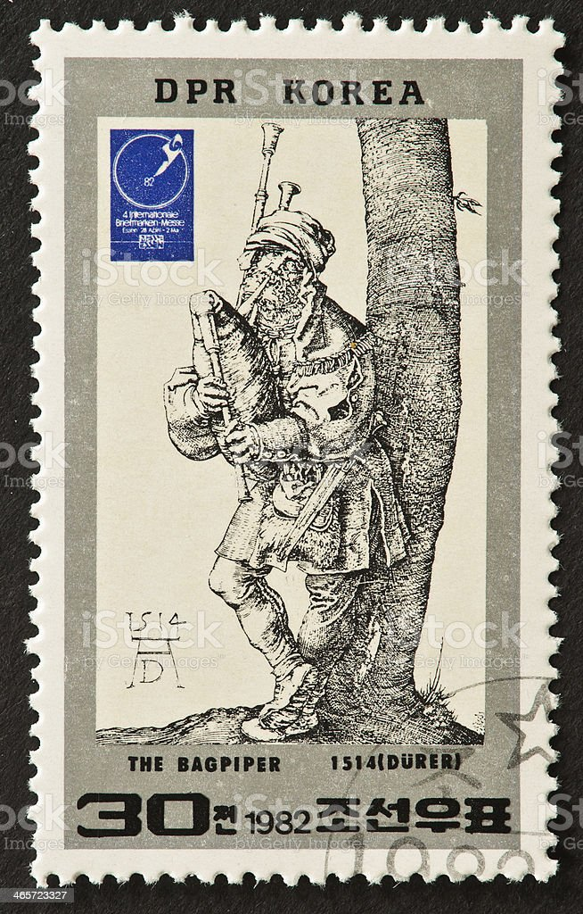 Durer's The Bagpiper Stamp stock photo