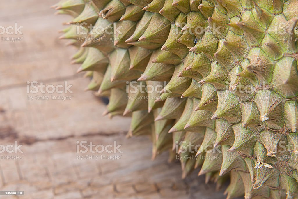 durian on the wooden floor stock photo