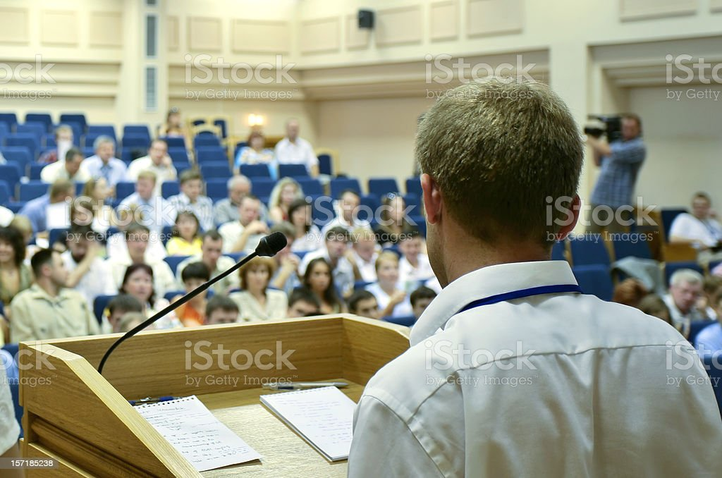 During the presentation the make speaker addressed a forum stock photo