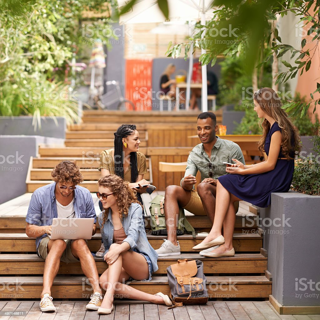 During their breaks they look for a digital escape! stock photo