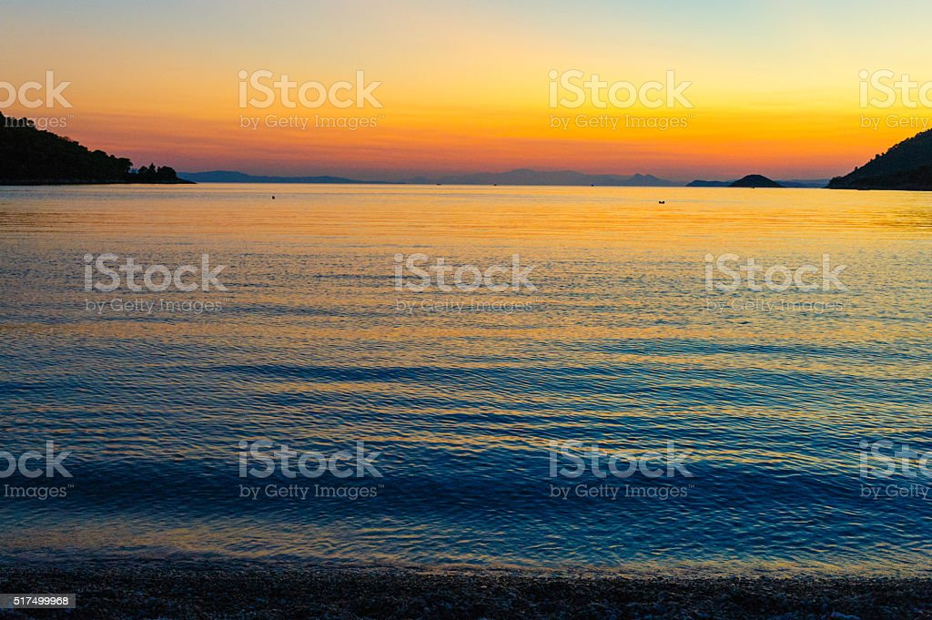 Dusk at Panormos bay stock photo