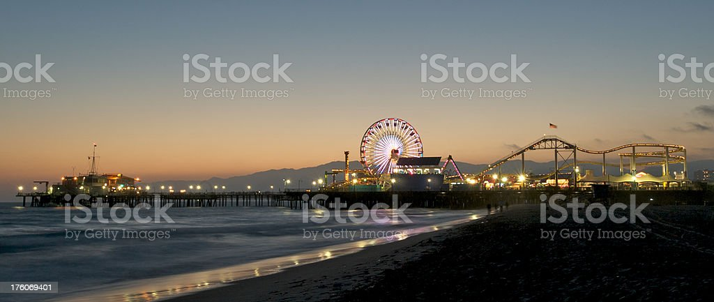 Dusk at Santa Monica Pier with Lighted Ferris Wheel royalty-free stock photo