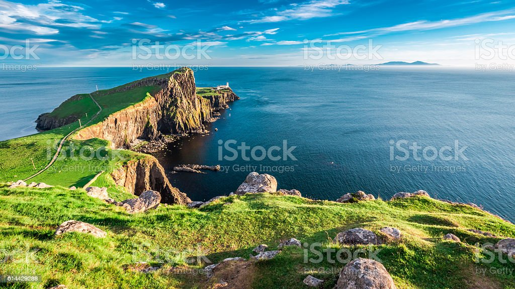Dusk at the Neist point lighthouse in Isle of Skye stock photo